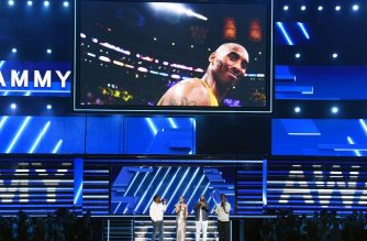 LOS ANGELES, CALIFORNIA - JANUARY 26: An image of the late Kobe Bryant is projected onto a screen while host Alicia Keys (2nd from L) and (from L) Nathan Morris, Wanya Morris, and Shawn Stockman of music group Boyz II Men perform onstage during the 62nd Annual GRAMMY Awards at STAPLES Center on January 26, 2020 in Los Angeles, California.   Kevin Winter/Getty Images for The Recording Academy /AFP