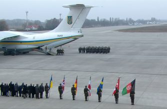 The bodies of downed plane victims arrive in Ukraine from Iran. Ukraine International Airlines Flight 752 crashed shortly after takeoff from Tehran on January 8 killing all 176 people onboard. President Volodymyr Zelensky, Prime Minister Oleksiy Goncharuk and other officials attend the ceremony at Kiev's Boryspil airport. (Photo grabbed from AFPTV video/Courtesy AFPTV)