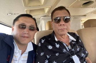 "President Rodrigo Duterte with Senator Christopher ""Bong"" Go inside the plane going to Manila from Davao City on Monday, Jan. 13.  The plane, upon Duterte's instructions, flew in areas affected by Taal volcano's eruption as the President wanted to see the situation in the area.  He will visit these areas on Tuesday, Jan. 14, according to him against his doctor's advice.  (Photo courtesy Sen. Bong Go)"