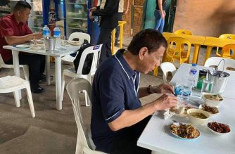 President Rodrigo Duterte eats at a local eatery on Saturday, Jan. 25./Senator Bong Go/