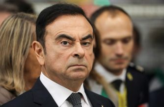 (FILES) In this file photo taken on November 08, 2018 then Chairman and CEO of Renault-Nissan-Mitsubishi Carlos Ghosn looks on during a visit of French President at the Renault factory, in Maubeuge, northern France. (Photo by Ludovic MARIN / AFP)