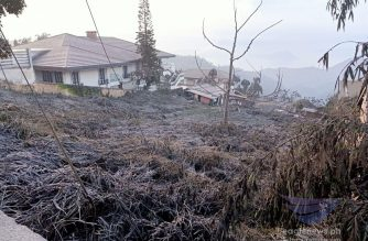 Thick layers of ashfall can be seen covering this grassy area in Tagaytay City on Monday morning, Jan. 13 after Taal volcano started to spew ash plumes and continues its eruptive activity.  (Photo by Earlo Bringas, Eagle News Service)