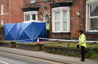 British Police officers stand by forensic tents outside a residential address in Stafford, central England on November 30, 2019, raided in connection with the November 29 stabbings on London Bridge in the City of London. - A man suspected of stabbing two people to death in a terror attack on London Bridge was an ex-prisoner convicted of terrorism offences and released last year, police said Saturday. (Photo by Oli SCARFF / AFP)