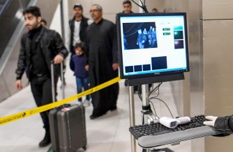 Temperature scanners are used to screen passengers for fever with upon their arrival at Kuwait international airport in Kuwait City on January 29, 2020. - The disease has spread to more than 15 countries since it emerged out of Wuhan late last year, with the death toll soaring to 132 and confirmed infections nearing 6,000.All confirmed fatalities have so far been in China. Cases have been reported across the Asia Pacific region and in North America and Europe, but the Wuhan family in the UAE are the first in the Middle East. (Photo by STR / AFP)