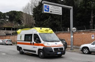 An ambulance drives past the Lazzaro Spallanzani National Institute for Infectious Diseases in Romeon January 31, 2020, where the two Chinese patients who tested positive for the coronavirus 2019-nCov, are being held in isolation. - The Italian government declared a state of emergency on January 31 to fast-track efforts to prevent the spread of the deadly coronavirus strain after two cases were confirmed in Rome. (Photo by Andreas SOLARO / AFP)