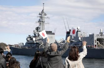 """People wave as Japan's Maritime Self-Defence Force destroyer """"Takanami"""" leaves for the Middle East at Yokosuka Naval Base in Yokosuka, Kanagawa prefecture on February 2, 2020. - Japan dispatched the naval destroyer to Middle East for a rare overseas mission to ensure safety of Japanese ships amid lingering tension between Iran and the US. (Photo by STR / JIJI PRESS / AFP) / Japan OUT"""