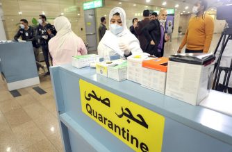 "Egyptian Quarantine Authority employees prepare to scan body temperature for incoming travellers at Cairo International Airport on February 1, 2020, amidst efforts to detect possible cases of SARS-like ""Wuhan coronavirus"" (novel coronavirus 2019-nCoV). (Photo by - / AFP)"