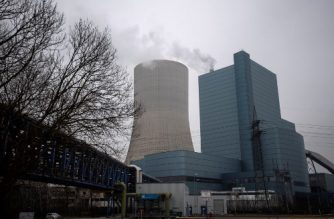 "(FILES) This file photo taken on January 24, 2020 shows a view of coal-fired power plant Datteln 4 in Datteln, western Germany. - Environmental activists occupied on February 2, 2020 the ""Datteln 4"" coal-fired power station, whose opening this summer is strongly criticized despite Germany's promise to abandon this polluting technology by 2038. (Photo by INA FASSBENDER / AFP)"