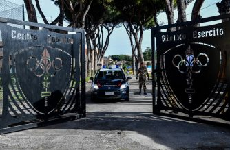 A car of the Italian Carabinieri police leaves the Cecchignola quarantine center, south of Rome, on February 3, 2020 where Italian citizens have been placed in quarantine after being repatriated from the coronavirus hot-zone of Wuhan at the nearby military airport of Pratica di Mare. (Photo by Tiziana FABI / AFP)