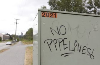 (FILES) In this file photo taken on June 20, 2019 anti-pipeline graffiti is pictured near the Kinder Morgan Burnaby Terminal and Tank Farm in Burnaby, British Columbia. - Canada's federal court on February 4, 2020 denied a bid by indigenous tribes to block a long-delayed expansion of an oil pipeline, saying they had been adequately consulted on the project. The decision is a win for Prime Minister Justin Trudeau, whose government in 2016 approved the Trans Mountain pipeline project connecting the Alberta oil sands to the Pacific coast for shipment to new overseas markets. (Photo by Jason Redmond / AFP)