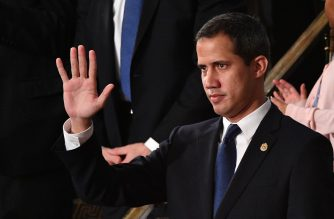 Venezuelan opposition leader Juan Guaido (C) waves as he is acknowledged by US President Donald Trump during his the State of the Union address at the US Capitol in Washington, DC, on February 4, 2020. (Photo by MANDEL NGAN / AFP)