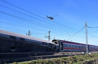 A Police helicopter flies over the wreckage of a derailed train, outside the city of Lodi, near Milan, northern Italy, on February 6, 2020. - Two people were killed and about 30 injured on February 6, 2020 when a high-speed train derailed near Milan in northern Italy, Italian media said. The accident occurred near the town of Lodi, about 50 kilometres (30 miles) south of Milan. The two people killed were rail workers on the train, the media said. (Photo by MIGUEL MEDINA / AFP)