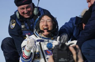 NASA astronaut Christina Koch reacts shortly after landing in a remote area outside the town of Dzhezkazgan (Zhezkazgan), Kazakhstan, on February 6, 2020. - NASA's Christina Koch returned to Earth safely Thursday having shattered the spaceflight record for female astronauts after almost a year aboard the International Space Station. Koch touched down at 0912 GMT on the Kazakh steppe after 328 days in space along with Luca Parmitano of the European Space Agency and Alexander Skvortsov of the Russian space agency. (Photo by Sergei ILNITSKY / POOL / AFP)