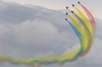 Members of the Chinese People's Liberation Army Air Force's Bayi Aerobatic Team fly J-10 performance aircraft as they take part in an aerial display during a media preview ahead of the Singapore Airshow in Singapore on February 9, 2020. (Photo by ROSLAN RAHMAN / AFP)