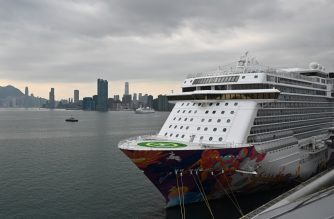 This general view shows the World Dream cruise ship as it docks at the Kai Tak cruise terminal in Hong Kong on February 9, 2020, where 3,600 people have remained confined aboard as authorities conducted health checks due to the outbreak of the new coronavirus in mainland China. - Twenty-six people in Hong Kong have tested positive so far for the new disease that emerged in central China at the end of last year, with nearly 37,200 people infected in mainland China. (Photo by Philip FONG / AFP)