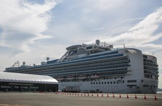 The Diamond Princess cruise ship, with around 3,600 people quarantined onboard due to fears of the deadly COVID-19 coronavius, is seen anchored at the Daikaku Pier Cruise Terminal in Yokohama on February 12, 2020. - A further 39 people on board the Diamond Princess cruise ship off the Japan coast have tested positive for the new coronavirus, authorities said on February 12, as thousands more steel themselves for a second week in quarantine. (Photo by Behrouz MEHRI / AFP)