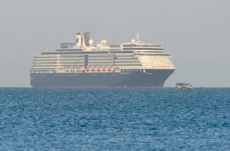 The Westerdam cruise ship approaches port in Sihanoukville, Cambodia's southern coast on February 13, 2020, where the liner had received permission to dock after been refused entry at other Asian ports due to fears of the COVID-19 coronavirus. - Japan, Guam, the Philippines, Taiwan and Thailand all refused to allow the ship to dock, despite operator Holland America insisting there were no cases of the deadly disease -- which has killed over 1,100 -- on board. (Photo by TANG CHHIN Sothy / AFP)