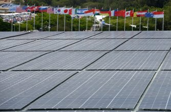 """This photograph taken on February 13, 2020 shows solar panels on the roof of the Changi Exhibition centre, where the Singapore Airshow is being held, in Singapore. - From an emissions-reducing model jet that looks like something from a sci-fi movie to electric aircraft and sustainable fuel, the aviation industry is ramping up efforts to go green as consumer pressure grows. """"Sustainability"""" was the buzzword last week in Singapore at Asia's biggest air show -- which was powered by solar panels -- with manufacturers and airlines trying to outdo one another with vows to become more sustainable. (Photo by Roslan RAHMAN / AFP) / TO GO WITH Asia-aviation-environment-Singapore, FOCUS by Catherine Lai and Sam Reeves"""