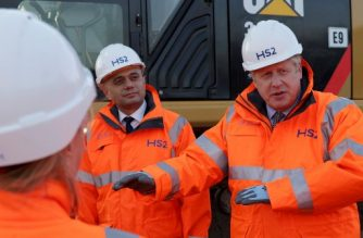 (FILES) In this file photo taken on February 11, 2020 Britain's Prime Minister Boris Johnson (R) talks as Britain's Chancellor of the Exchequer Sajid Javid (L) listens during their visit to Curzon Street railway station in Birmingham, central England on February 11, 2020, where the High Speed 2 (HS2) rail project is under construction. - Britain's finance minister, Sajid Javid, resigned on February 13, 2020, just weeks after Brexit and a month before he was due to deliver the government's annual budget. Javid's spokesman confirmed he would be leaving just as Prime Minister Boris Johnson carried out the first reshuffle of his cabinet since winning a parliamentary majority in December's election. (Photo by EDDIE KEOGH / POOL / AFP)