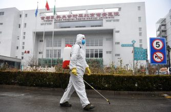(File photo) A worker sterilizes a path at the Youan Hospital in Beijing on February 14, 2020. - Youan Hospital is one of twenty hospitals in Beijing treating coronavirus patients. Six health workers have died from the COVID-19 coronavirus in China and more than 1,700 have been infected, health officials said on February 14, underscoring the risks doctors and nurses have taken due to shortages of protective gear. (Photo by GREG BAKER / AFP)