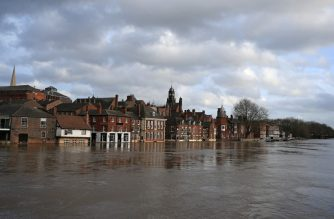 "Floodwater rises up the front buildings alongside the River Ouse in central York after the river burst its banks in York, northern England, on February 17, 2020, in the aftermath of Storm Dennis. - Britain on February 17 began to clear up after Storm Dennis battered the country over the weekend, leading the government's weather agency to issue a rare ""danger to life"" warning amid widespread flooding and high winds. (Photo by Lindsey Parnaby / AFP)"