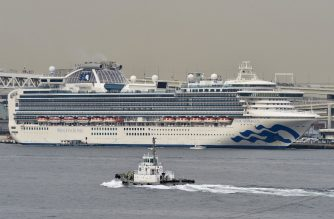 "The Diamond Princess cruise ship (back) in quarantine due to fears of the new COVID-19 coronavirus, is seen at the Daikoku Pier Cruise Terminal in Yokohama on February 20, 2020. - Two former passengers of the coronavirus-wracked Diamond Princess have died, local media reported, as fears mount about those who have left the ship after testing negative for the virus. (Photo by Kazuhiro NOGI / AFP) / ""The erroneous mention[s] appearing in the metadata of this photo by Kazuhiro NOGI has been modified in AFP systems in the following manner: changes dateline to [YOKOHAMA] instead of [HONG KONG], and changes slug in object name metadata to [JAPAN] instead of [HONG KONG]. Please immediately remove the erroneous mention[s] from all your online services and delete it (them) from your servers. If you have been authorized by AFP to distribute it (them) to third parties, please ensure that the same actions are carried out by them. Failure to promptly comply with these instructions will entail liability on your part for any continued or post notification usage. Therefore we thank you very much for all your attention and prompt action. We are sorry for the inconvenience this notification may cause and remain at your disposal for any further information you may require."""