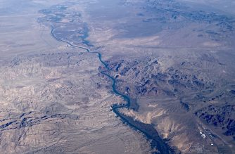 (FILES) In this file photo taken on February 6, 2020 This aerial view shows the Colorado River, south of Las Vegas. - The massive Colorado River, which provides water for seven US states, has seen its flow reduced by 20 percent over the course of a century -- and more than half of that loss is due to climate change, according to new research published on February 20, 2020. Two scientists at the US Geological Survey developed a mathematical model of the water movements -- snowfall, rainfall, run-off, evaporation -- in the upper Colorado River basin for the period from 1913 to 2017. (Photo by Daniel SLIM / AFP)
