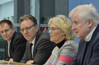 "(R-L) German Interior minister Horst Seehofer, Justice Minister Christine Lambrecht, the President of the Federal Criminal Office Holger Muench, and German chief federal prosecutor Peter Frank  address a press conference, on February 21, 2020 in Berlin, one day after the deadly mass shooting born of racist motives in Hanau. - Seehofer said German police will ""increase presence"" nationwide and at mosques. After Germany was stunned by a mass shooting born of racist motives, ministers came under pressure from threatened communities to present new measures against extreme-right violence. (Photo by Tobias SCHWARZ / AFP)"