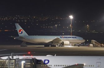 A Korean airplane which arrived from South Korea is pictured after landing at Ben Gurion International Airport on February 22, 2020. - Israel refused to allow some 200 non-Israelis to disembark from a plane which arrived from South Korea, as part of measures against the new coronavirus, the health ministry said. It said the plane was made to return to South Korea, after the 12 Israeli passengers on board were taken away in ambulances waiting at Tel Aviv to be quarantined. (Photo by Ahmad GHARABLI / AFP)