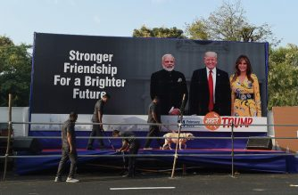 "Gujarat police's bomb detection disposal squad officials along with a sniffer dog inspect a stage displaying pictures of India's Prime Minister Narendra Modi (L), US President Donald Trump (C) and First Lady Melania Trump (R), on the outskirts of Ahmedabad on February 23, 2020, ahead of Trump's visit to India. - Trade ties between the United States and India have long been problematic but under ""America First"" President Donald Trump and ""Make in India"" Prime Minister Narendra Modi, they have worsened. While eclipsed by his trade war with China, Trump's tussle with India, and New Delhi's prickly reaction, has made a major pact unlikely during the American president's visit to the world's fifth-largest economy from February 24. (Photo by SAM PANTHAKY / AFP)"