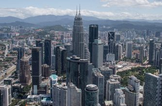 """This general view shows the Kuala Lumpur city skyline as seen from the Kuala Lumpur Tower on February 24, 2020. - Malaysian politics was in turmoil on February 24 after leader-in-waiting Anwar Ibrahim denounced a """"betrayal"""" by coalition partners he said were trying to bring down the government, two years after it stormed to victory. (Photo by Mohd RASFAN / AFP)"""