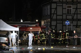 Police officers investigate the car of the man who drove into a carnival procession on February 24, 2020 in Volkmarsen near Kassel, central Germany. - Several people were injured when a car drove into a carnival procession in Volksmarsen, police said, adding that the driver had been arrested. (Photo by INA FASSBENDER / AFP)