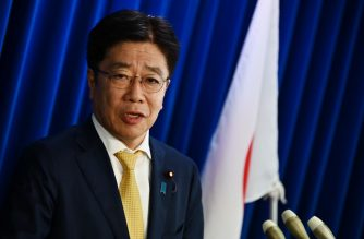 Japan's Health Minister Katsunobu Kato speaks during a press conference on the COVID-19 coronavirus at the ministry in Tokyo on February 25, 2020. - Japan has more than 140 cases of the COVID-19 coronavirus and four have died. Three of those deaths were passengers who had been on the cruise ship Diamond Princess, quarantined off in Yokohama, where the number of infections is over 690. (Photo by CHARLY TRIBALLEAU / AFP)