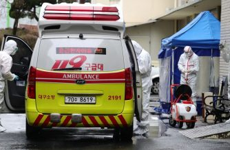 "A medical worker sprays disinfectant into an ambulance at a hospital where patients infected with the COVID-19 coronavirus are being treated, in the southeastern city of Daegu on February 25, 2020. - The novel coronavirus outbreak in South Korea is ""very grave"", President Moon Jae-in said on February 25 as he visited its epicentre and the country's total number of cases approached 1,000. (Photo by - / YONHAP / AFP) / - South Korea OUT / REPUBLIC OF KOREA OUT  NO ARCHIVES  RESTRICTED TO SUBSCRIPTION USE"