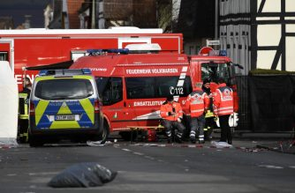 Vehicles of the police and the fire brigades stand at the site where a man who drove into a carnival procession, on February 25, 2020 in Volkmarsen near Kassel, central Germany. - A car that rammed into a carnival procession in Volkmarsen on Rose Monday, February 24, 2020, injured 52 people, including 18 children, police said, adding that the perpetrator's motive remains unclear. (Photo by INA FASSBENDER / AFP)