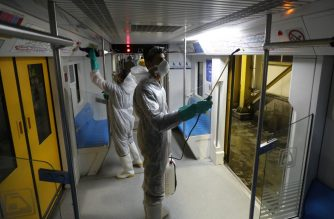 Tehran Municipality workers clean a metro train to avoid the spread of the COVID-19 illness on February 26, 2020. - Iran said Tuesday its coronavirus outbreak, the deadliest outside China, had claimed 15 lives and infected nearly 100 others -- including the country's deputy health minister. The Islamic republic's neighbours have imposed travel restrictions and strict quarantine measures after reporting their first cases in recent days, mostly in people with links to Iran. (Photo by ATTA KENARE / AFP)