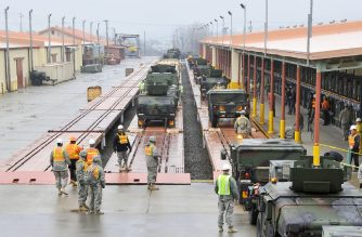 (FILES) In this file photo taken on March 6, 2012, US military vehicles are driven onto a train during a railhead operation of prepositioned equipment at Camp Carroll in Chilgok, 220 kms southeast of Seoul. - An American soldier stationed at Camp Carroll in South Korea has tested positive for the COVID-19 coronavirus, commanders said February 26, 2020, as the country's case total jumped again. (Photo by Jung Yeon-je / AFP)