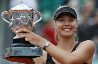 (FILES) In this file photo taken on June 9, 2012, Russia's Maria Sharapova holds a trophy after winning over Italy's Sara Errani during their Women's Singles final tennis match of the French Open tennis tournament at the Roland Garros stadium, in Paris. (Photo by PATRICK KOVARIK / AFP)