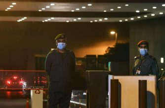 Private security guards wear protective facemasks at the main entrance  of the Aga Khan University Hospital where a patient of the COVID-19 novel coronavirus has been admitted in Karachi on February 26, 2020. - Pakistan has detected its first two cases of novel coronavirus, a public health advisor to the prime minister tweeted on February 26, days after Islamabad closed its land border with Iran, where 19 people have died from the virus. (Photo by Asif HASSAN / AFP)