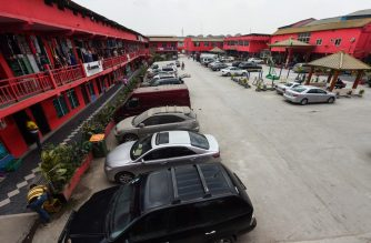 "A picture taken on February 27, 2020 shows the deserted China Commercial City shopping centre, popularly called ""China Town"", as people fear of contracting the COVID-19, the novel coronavirus in Ojota in Lagos. - The shopping centre, popularly known as China Town, with over 300 shops and 200 apartment units was opened in 2005 with the aim to facilitate trade and deepen China - Nigeria relationships, but has since the outbreak of Coronavirus witnessed low patronage by traders despite no confirmed coronavirus cases in the country. (Photo by PIUS UTOMI EKPEI / AFP)"