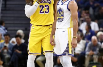 SAN FRANCISCO, CALIFORNIA - OCTOBER 05: LeBron James #23 of the Los Angeles Lakers talks to Stephen Curry #30 of the Golden State Warriors during their game at Chase Center on October 05, 2019 in San Francisco, California. NOTE TO USER: User expressly acknowledges and agrees that, by downloading and or using this photograph, User is consenting to the terms and conditions of the Getty Images License Agreement.   Ezra Shaw/Getty Images/AFP
