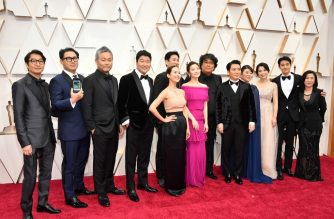 HOLLYWOOD, CALIFORNIA - FEBRUARY 09: Cast and crew of 'Parasite' including editor Yang Jin-mo, writer Jin Won Han, producer Kwak Sin-ae, production designer Ha-jun Lee, Yang-kwon Moon, Kang-ho Song, Yeo-jeong Jo, Sun-kyun Lee, and filmmaker Bong Joon Ho attend the 92nd Annual Academy Awards at Hollywood and Highland on February 09, 2020 in Hollywood, California.   Amy Sussman/Getty Images/AFP