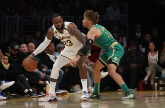 LOS ANGELES, CALIFORNIA - FEBRUARY 23: LeBron James #23 of the Los Angeles Lakers handles the ball against Romeo Langford #45 of the Boston Celtics during the third quarter at Staples Center on February 23, 2020 in Los Angeles, California.   Katelyn Mulcahy/Getty Images/AFP