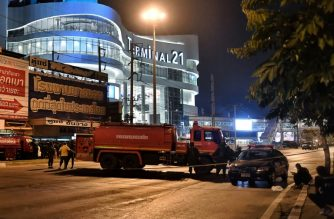 Police set up a cordon around the Terminal 21 shopping mall in Nakhon Ratchasima, Thailand, after a gunman inside opened deadly fire killing at least 20. /Lilian Suwanrumpha/AFP