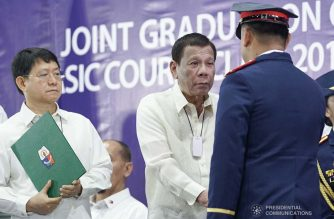President Rodrigo Duterte congratulates one of the graduates of the Public Safety Officers Basic Course Class 2019-07 and the Public Safety Officers Advance Course Class 2019-18 during a ceremony at the Arcadia Active Lifestyle Center in Davao City on February 20, 2020. ARMAN BAYLON/PRESIDENTIAL PHOTO