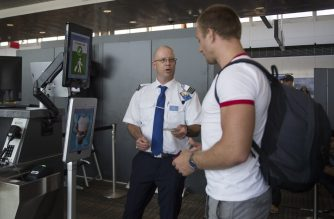 A man boarding a SAS flight to Copenhagen goes through facial recognition verification system VeriScan at Dulles International Airport in Dulles, Virginia, on September 6, 2018. (Photo by Jim WATSON / AFP)