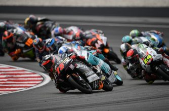 Sama Qatar Angel Nieto Team's Spanish rider Albert Arenas leads the pack during the Moto3-class Malaysian Grand Prix motorcycle race at the Sepang International Circuit in Sepang on November 3, 2019. (Photo by Mohd RASFAN / AFP)