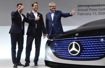 "Ola Kaellenius (C), CEO of Daimler AG, Harald Wilhelm, (L) CFO of Daimler AG and Martin Daum (R), member of the executive board and CEO of Daimler Trucks AG pose during the company's annual press conference in Stuttgart, southern Germany, on February 11, 2020. - Mercedes-Benz parent company Daimler reported plunging profits for 2019, after setting aside billions of euros to deal with potential fallout from the industry-wide ""dieselgate"" emissions cheating scandal. (Photo by THOMAS KIENZLE / AFP)"