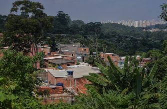 General view of the Favela Nova Esperanca -a 'green favela' which reuses everything and is subject to the ethics of permaculture- in the outskirts of Sao Paulo, Brazil, on February 14, 2020. - An hour from downtown Sao Paulo, the community of Vila Nova Esperanza, on a hill from which the lush Atlantic forest dominates, seeks to respect the environment, be self-sufficient and share. (Photo by Nelson ALMEIDA / AFP)