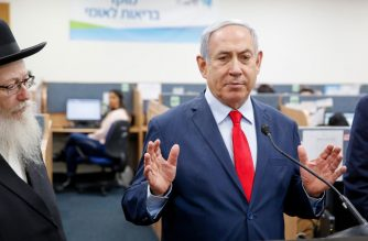 Israeli Prime Minister Benjamin Netanyahu delivers a speech, alongside Israeli Health Minister Yaakov Litzman (L), during a visit to the Corona virus outbreak central response unit at Israeli Ministry of Health in the Israeli city of Kiryat Malakhi on March 1, 2020. (Photo by GIL COHEN-MAGEN / AFP)